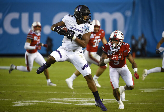 Northwestern wide receiver Cameron Green (84) makes a catch in front of the defense of Utah defensive back Tareke Lewis (5) during the first half of the Holiday Bowl NCAA college football game Monday, Dec. 31, 2018, in San Diego. (AP Photo/Denis Poroy)
