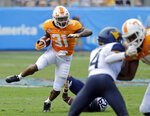 Tennessee's Madre London (31) runs against West Virginia in the first half of an NCAA college football game in Charlotte, N.C., Saturday, Sept. 1, 2018. (AP Photo/Chuck Burton)