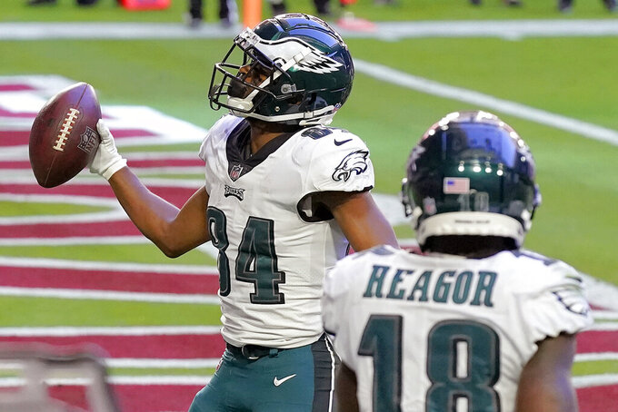 Philadelphia Eagles wide receiver Greg Ward (84) celebrates his touchdown catch against the Arizona Cardinals during the first half of an NFL football game, Sunday, Dec. 20, 2020, in Glendale, Ariz. (AP Photo/Ross D. Franklin)