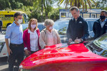 On the hood of an electric car, California Gov. Gavin Newsom signs an executive order requiring all new passenger vehicles sold in the state to be zero-emission by 2035 after a press conference on Wednesday, Sept. 23, 2020, at Cal Expo in Sacramento. It's a move the governor says would achieve a significant reduction in greenhouse gas emissions. California would be the first state with such a rule, though Germany and France are among 15 other countries that have a similar requirement. (Daniel Kim/The Sacramento Bee via AP, Pool)