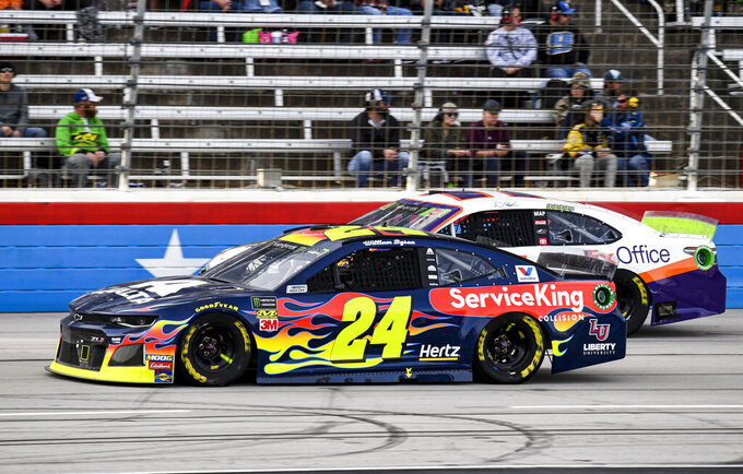 William Byron (24) and Denny Hamlin (11) battle for position during a NASCAR Cup Series auto race at Texas Motor Speedway, Sunday, Nov. 3, 2019, in Fort Worth, Texas. (AP Photo/Larry Papke)