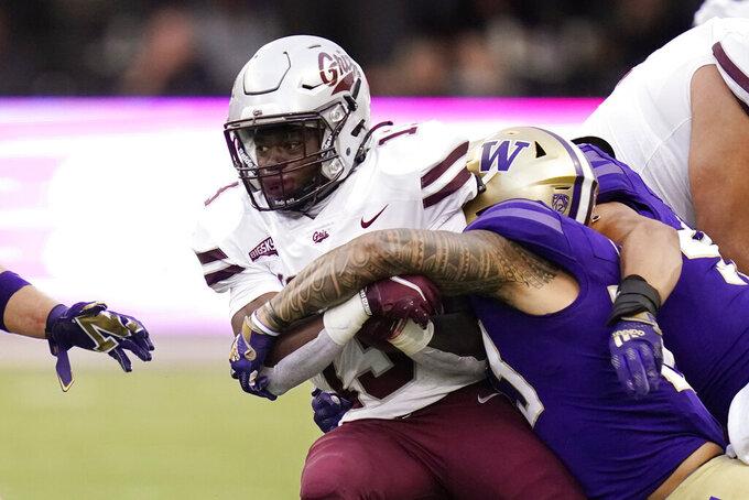 Montana's Xavier Harris carries against Washington during the second half of an NCAA college football game Saturday, Sept. 4, 2021, in Seattle. Montana won 13-7. (AP Photo/Elaine Thompson)