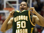 FILE - In this March 19, 2006, file photo, George Mason forward Sammy Hernandez (50) celebrates as George Mason beat North Carolina in the NCAA second-round men's basketball game in Dayton, Ohio. No one saw a Final Four run coming after the team that lost in the Colonial Athletic Association semifinals. George Mason beat Michigan State, North Carolina and Wichita State before taking down No. 1 seed Connecticut and its roster full of NBA talent, 86-84 in overtime. They lost 73-58 to eventual national champion Florida in the semifinals.(AP Photo/Al Behrman, File)