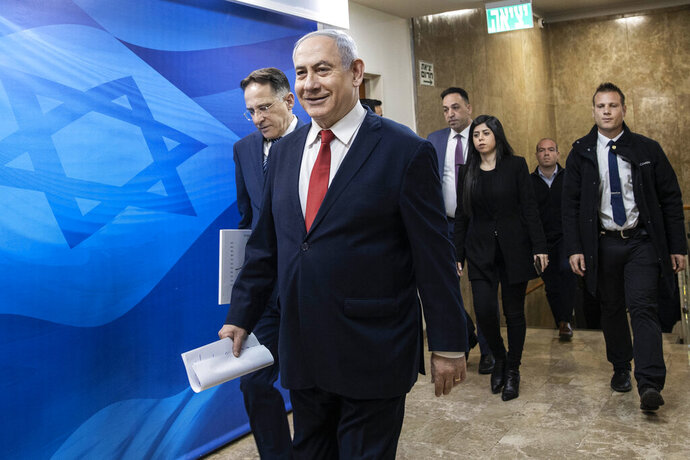 Israeli Prime Minister Benjamin Netanyahu arrives for the weekly cabinet meeting at the Prime Minister's office in Jerusalem, Sunday, Jan. 12, 2020. (AP Photo/Tsafrir Abayov, Poo)