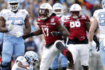 Temple defensive end Dana Levine (17) celebrates after making a tackle on North Carolina running back Michael Carter (8) during the first half of the Military Bowl NCAA college football game, Friday, Dec. 27, 2019, in Annapolis, Md. (AP Photo/Julio Cortez)