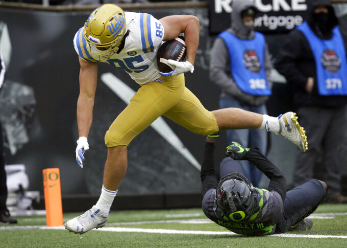 UCLA'S Greg Dulcich scores a touchdown against Oregon during the third quarter of an NCAA college football game Saturday, Nov. 21, 2020, in Eugene, Ore. (AP Photo/Chris Pietsch)