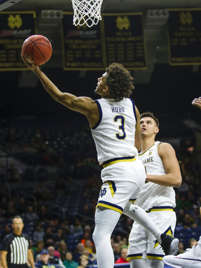 Notre Dame's Prentiss Hubb (3) drives to the basket during an NCAA college basketball game against Robert Morris Saturday, Nov. 9, 2019 at Purcell Pavilion in South Bend, Ind. (Michael Caterina/South Bend Tribune via AP)