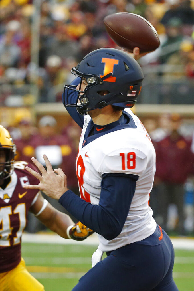Illinois quarterback Brandon Peters (18) passes against Minnesota in the first quarter of an NCAA college football game Saturday, Oct. 5, 2019, in Minneapolis. (AP Photo/Bruce Kluckhohn)