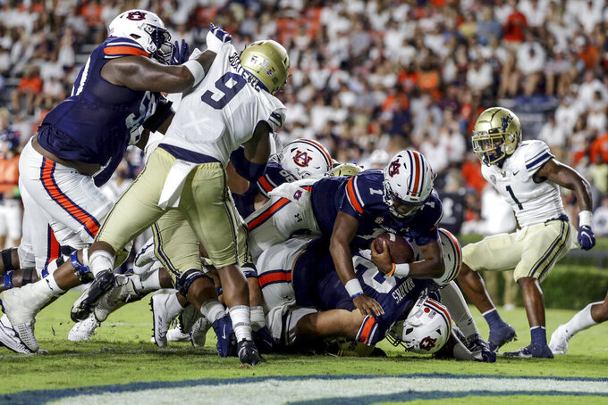 Auburn quarterback TJ Finley (1) dives over the top for a touchdown against Akron during the second half of an NCAA college football game Saturday, Sept. 4, 2021, in Auburn, Ala. (AP Photo/Butch Dill)