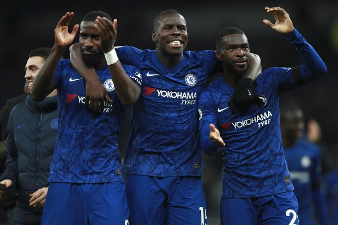 From left, Chelsea's Antonio Rudiger, Kurt Zouma and Fikayo Tomori celebrate their side's 2-0 win at the end of the English Premier League soccer match between Tottenham Hotspur and Chelsea, at the Tottenham Hotspur Stadium in London, Sunday, Dec. 22, 2019. (AP Photo/Ian Walton)