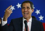 Venezuela's opposition leader and self-proclaimed interim President Juan Guaido speaks to journalists during a press conference in Caracas, Venezuela, Monday, June 17, 2019. (AP Photo/Ariana Cubillos)
