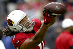 Arizona Cardinals wide receiver Larry Fitzgerald warms up prior an NFL football game against the Seattle Seahawks, Sunday, Sept. 29, 2019, in Glendale, Ariz. (AP Photo/Ross D. Franklin)