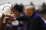 Detroit Mercy head coach Mike Davis talks to his guard Antoine Davis, his son, during the second half of an NCAA college basketball game against IUPUI, Thursday, Feb. 28, 2019, in Detroit. Davis tied and broke Steph Curry's NCAA record for 3-point baskets by a freshman. (AP Photo/Carlos Osorio)