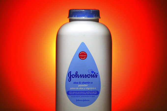 FILE - This Oct. 21, 2019 file, photo shows Johnson's Baby Aloe & Vitamin E Powder in Salt Lake City. Johnson & Johnson reported a strong finish to the year, overcoming the disruption of the global pandemic on some parts of its business like medical devices.  The New Brunswick, New Jersey-based company said it had profit of 65 cents per share. (AP Photo/Rick Bowmer, File)