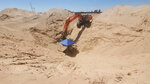 In this undated photo provided by U.S. Immigration and Customs Enforcement, excavation work continues at a site of an incomplete tunnel intended for smuggling, found stretching from Arizona to Mexico. (Courtesy of ICE via AP)