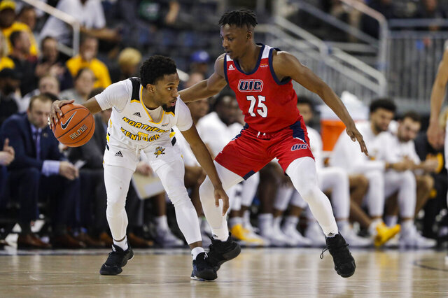 Illinois-Chicago guard Godwin Boahen (25) defends against Northern Kentucky guard Bryson Langdon (5) during the second half of an NCAA college basketball game for the Horizon League men's tournament championship in Indianapolis, Tuesday, March 10, 2020. Northern Kentucky won 71-62. (AP Photo/Michael Conroy)