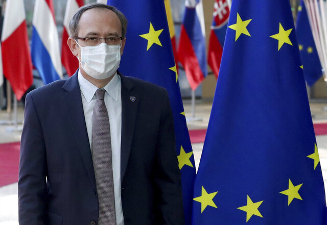 Kosovo's Prime Minister Avdullah Hoti poses for photographers prior to a meeting with European Council President Charles Michel at the Europa building in Brussels, Thursday, June 25, 2020. (Yves Herman, Pool Photo via AP)