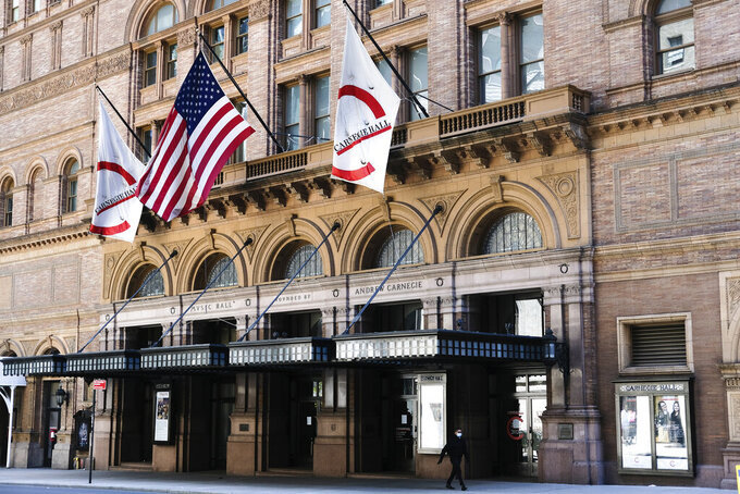 FILE - This May 12, 2020 file photo shows Carnegie Hall in New York. Carnegie Hall will miss an entire season for the first time for the first time in its 130-year history. Carnegie canceled performances from April 6 through July at its three venues, extending a closure that started last March 13 due to the novel coronavirus pandemic. (Photo by Evan Agostini/Invision/AP, File)