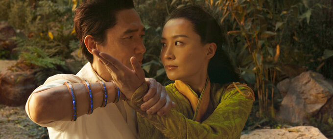 """This image released by Marvel Studios shows Tony Leung, left, and Fala Chen in a scene from """"Shang-Chi and the Legend of the Ten Rings."""" (Marvel Studios via AP)"""