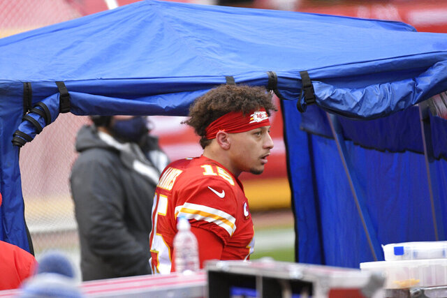 Kansas City Chiefs quarterback Patrick Mahomes enters the injury tent during the second half of an NFL divisional round football game against the Cleveland Browns, Sunday, Jan. 17, 2021, in Kansas City. (AP Photo/Reed Hoffmann)