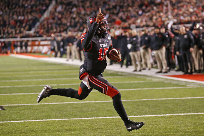 Utah quarterback Jason Shelley (15) scores against California in the first half of an NCAA college football game Saturday, Oct. 26, 2019, in Salt Lake City. (AP Photo/Rick Bowmer)