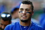 Chicago Cubs' Javier Baez smiles in the dugout after hitting a grand slam off Cincinnati Reds relief pitcher Jared Hughes during the eighth inning of a baseball game, Saturday, June 29, 2019, in Cincinnati. (AP Photo/Gary Landers)