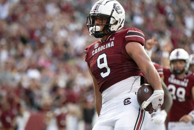 South Carolina tight end Nick Muse (9) reacts after scoring against Eastern Illinois during the first half of an NCAA college football game on Saturday, Sept. 4, 2021, in Columbia, S.C. (AP Photo/Hakim Wright Sr.)