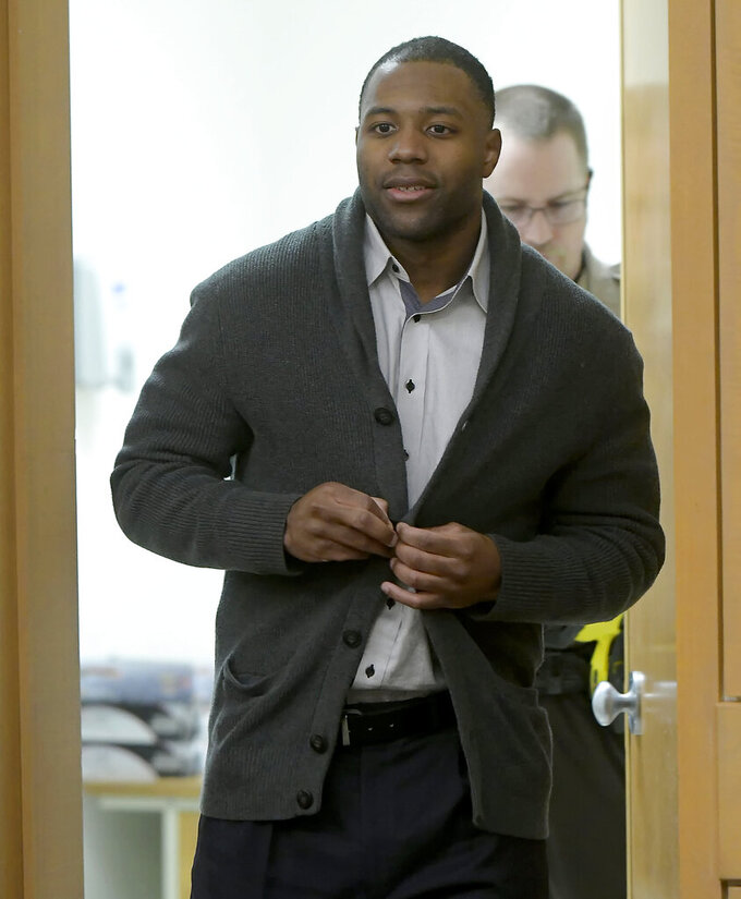 Torrey Green enters the courtroom to hear the juries verdict in his rape case, Friday, Jan. 18, 2019, in Brigham City, Utah. Green was found guilty of eight charges including five counts of rape and a charge sexual battery in connection to reports from six women accusing him of sexual assault while he was a football player at Utah State University, Friday, Jan.18, 2019 in Brigham City, Utah. (Eli Lucero/Herald Journal via AP, Pool)