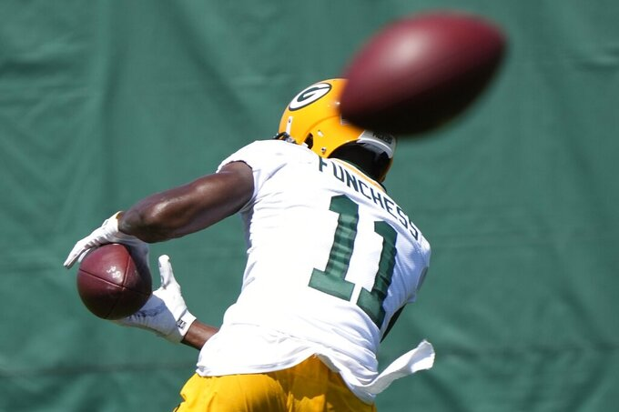 Green Bay Packers' Devin Funchess runs a drill during an NFL football minicamp Tuesday, June 8, 2021, in Green Bay, Wis. (AP Photo/Morry Gash)