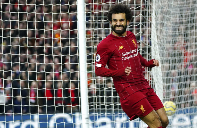 Liverpool's Mohamed Salah celebrates after scoring his sides third goal during the English Premier League soccer match between Liverpool and Southampton at Anfield Stadium, Liverpool, England, Saturday, February 1, 2020. (AP Photo/Jon Super)
