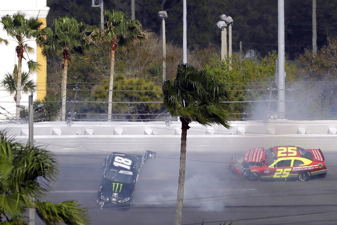 Riley Herbst (18) and Chris Cockrum (25) crash during the NASCAR Xfinity series auto race Saturday, Feb. 15, 2020, at Daytona International Speedway in Daytona Beach, Fla. (AP Photo/Chris O'Meara)