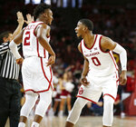 Oklahoma's Aaron Calixte (2) and Christian James (0) react after Calixte made a 3-point shot during the second half of the team's NCAA college basketball game against Vanderbilt in Norman, Okla., Saturday, Jan. 26, 2019. (Nate Billings/The Oklahoman via AP)
