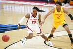 Alabama's John Petty Jr. (23) chases the ball after it was knocked away by Maryland's Aaron Wiggins (2) during the first half of a college basketball game in the second round of the NCAA tournament at Bankers Life Fieldhouse in Indianapolis Monday, March 22, 2021. (AP Photo/Mark Humphrey)