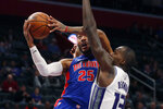 Detroit Pistons guard Derrick Rose (25) attempts a layup as Sacramento Kings center Dewayne Dedmon (13) defends during the first half of an NBA basketball game, Wednesday, Jan. 22, 2020, in Detroit. (AP Photo/Carlos Osorio)