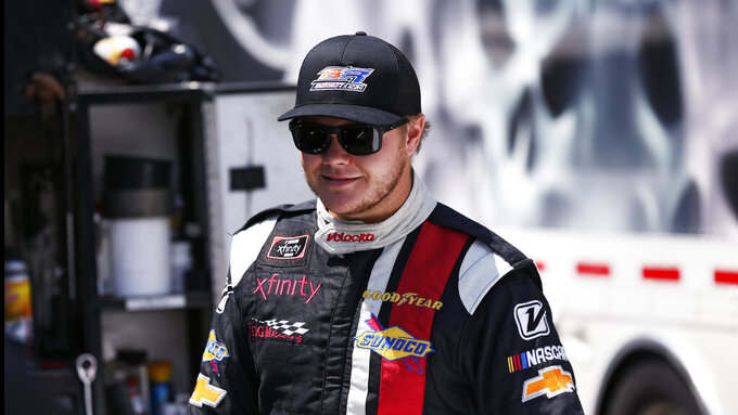 Driver Ronnie Bassett Jr. is seen in the pits before practice for an NASCAR Xfinity Series auto race on Thursday, Aug. 15, 2019, in Bristol, Tenn. (AP Photo/Wade Payne)