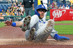 Los Angeles Dodgers' Matt Beaty scores on a double by Max Muncy off Pittsburgh Pirates starting pitcher Michael Feliz during the first inning of a baseball game in Pittsburgh, Friday, May 24, 2019. (AP Photo/Gene J. Puskar)