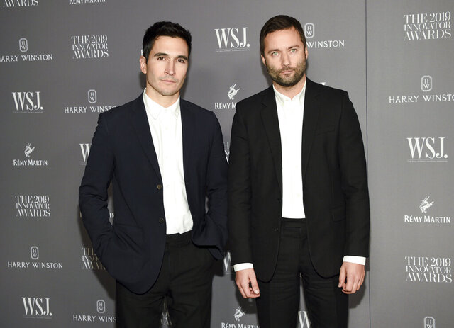 FILE - Designers Lazaro Hernandez, left, and Jack McCollough attend the WSJ. Magazine 2019 Innovator Awards in New York on Nov. 6, 2019. The designer duo have been thinking about longterm changes to the way they and their colleagues work. In an interview they mused that maybe less is more and they don't need to do runway shows with every collection. (Photo by Evan Agostini/Invision/AP, File)