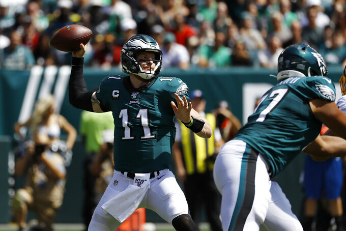 Philadelphia Eagles' Carson Wentz passes during the first half of an NFL football game against the Washington Redskins, Sunday, Sept. 8, 2019, in Philadelphia. (AP Photo/Michael Perez)