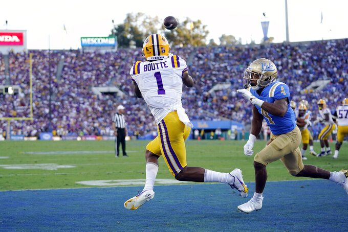 LSU wide receiver Kayshon Boutte (1) catches a pass for a touchdown in front of UCLA defensive back Stephan Blaylock (4) during the first half of an NCAA college football game Saturday, Sept. 4, 2021, in Pasadena, Calif. (AP Photo/Marcio Jose Sanchez)