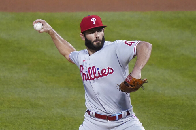 FILE - In this Sept. 4, 2020, file photo, Philadelphia Phillies starting pitcher Jake Arrieta throws in the first inning of a baseball game against the New York Mets in New York. Arrieta is returning to the Chicago Cubs, agreeing to a $6 million, one-year contract on Friday, Feb. 12, 2021. Arrieta can earn $1 million in performance bonuses, according to a person familiar with the situation who confirmed the deal on condition of anonymity because it is pending a physical. (AP Photo/John Minchillo, File)