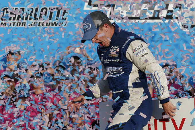 AJ Allmendinger celebrates in victory lane after winning the NASCAR Xfinity Series auto race at Charlotte Motor Speedway in Concord, N.C., Saturday, Sept. 28, 2019. (AP Photo/Gerry Broome)