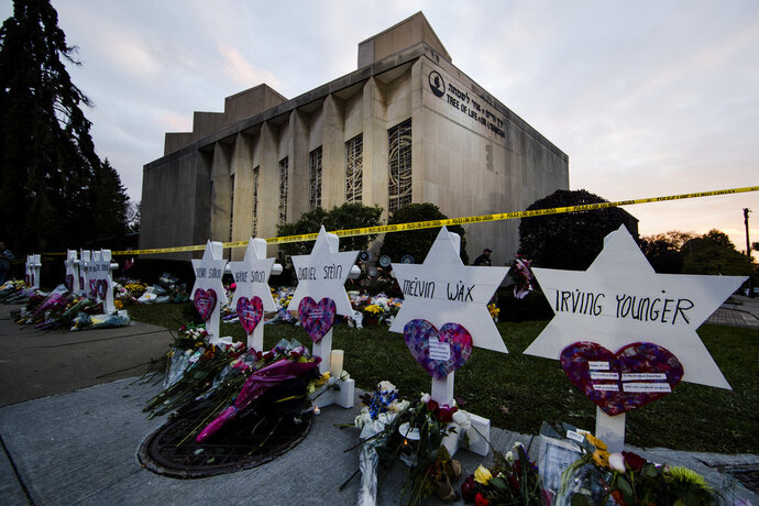 FILE - In this Oct. 29, 2018, file photo, a makeshift memorial stands outside the Tree of Life synagogue in the aftermath of a deadly shooting at the in Pittsburgh. A moment of silence to honor the 11 people killed in the synagogue shooting is planned for a downtown Pittsburgh park, on Friday, Nov. 9. (AP Photo/Matt Rourke, File)