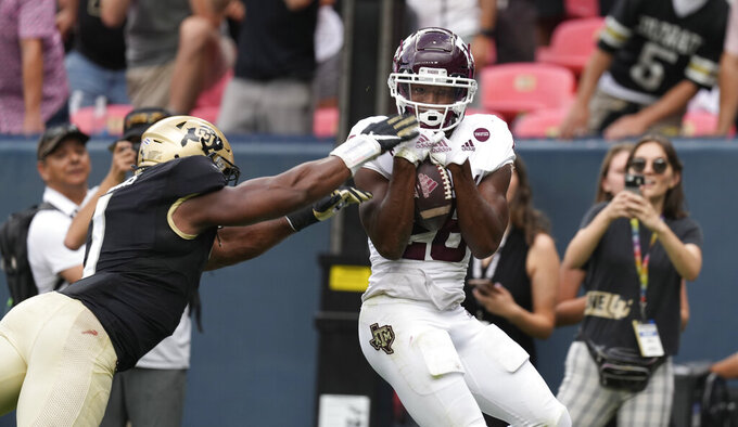 Texas A&M running back Isaiah Spiller, right, catches a pass for a touchdown as Colorado linebacker Guy Thomas defends in the second half of an NCAA college football game Saturday, Sept. 11, 2021, in Denver. Texas A&M won 10-7. (AP Photo/David Zalubowski)