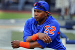 FILE - In this July 20, 2018, file photo, New York Mets' Yoenis Cespedes stretches before a baseball game against the New York Yankees in New York. When baseball comes back next month, Cespedes might finally be ready to return, too. Sidelined for nearly two years by injuries and then the coronavirus pandemic, the Mets slugger could be healthy enough at last to play on opening day in late July — especially with the designated hitter available in the National League this season. General manager Brodie Van Wagenen said Monday, June 29, 2020, the team is optimistic about Céspedes. (AP Photo/Julie Jacobson, File)