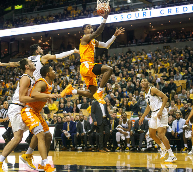 Tennessee's Jordan Bone, center, shoots between Missouri defenders during the first half of an NCAA college basketball game Tuesday, Jan. 8, 2019, in Columbia, Mo. (AP Photo/L.G. Patterson)