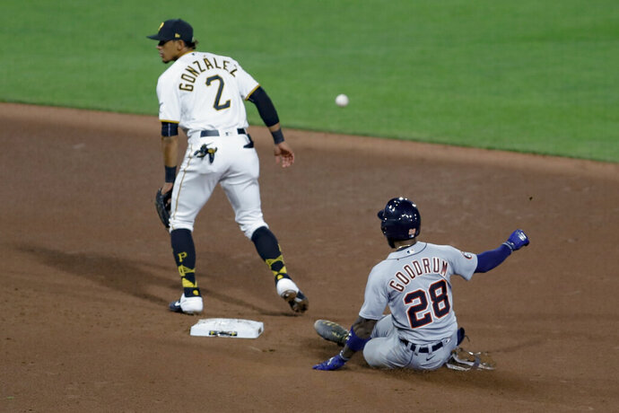 Detroit Tigers' Niko Goodrum (28) slides into second with an RBI double as the throw from Pittsburgh Pirates center fielder Cole Tucker heads to second baseman Erik Gonzalez (2) in the seventh inning of a baseball game, Friday, Aug. 7, 2020, in Pittsburgh. The hit drove in two runs. (AP Photo/Keith Srakocic)