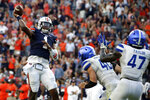 Auburn quarterback TJ Finley (1) throws a pass for a touchdown to take the lead over Georgia State in  the final minute of the second half of an NCAA football game Saturday, Sept. 25, 2021, in Auburn, Ala. (AP Photo/Butch Dill)