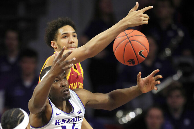 Kansas State forward Makol Mawien, front, rebounds against Iowa State guard Terrence Lewis, back, during the second half of an NCAA college basketball game in Manhattan, Kan., Saturday, March 7, 2020. (AP Photo/Orlin Wagner)