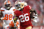 FILE - In this  Monday, Oct. 7, 2019 file photo, San Francisco 49ers running back Tevin Coleman (26) runs for a touchdown against the Cleveland Browns during the first half of an NFL football game in Santa Clara, Calif. The New York Jets added experience and depth on both sides of the ball with their latest moves in free agency. The team announced Wednesday, March 24, 2021 it signed former Philadelphia Eagles defensive end Vinny Curry, who'll provide an already formidable D-line a veteran pass-rushing presence. The Jets also agreed to terms on a one-year contract with running back Tevin Coleman. (AP Photo/Tony Avelar, File)