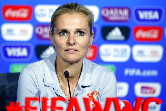 FILE - In this Saturday, July 6, 2019 file photo, Netherlands' head coach Sarina Wiegman attends a press conference at the Stade de Lyon, outside Lyon, France. Wiegman will leave her role as manager of the Netherlands' women's team after next year's Olympic Games to take charge of England as the replacement for Phil Neville, it was announced Friday, Aug. 14, 2020. Wiegman will be installed in September 2021 ahead of the European Championship in 2022 that is being staged in England. (AP Photo/Francois Mori, file)